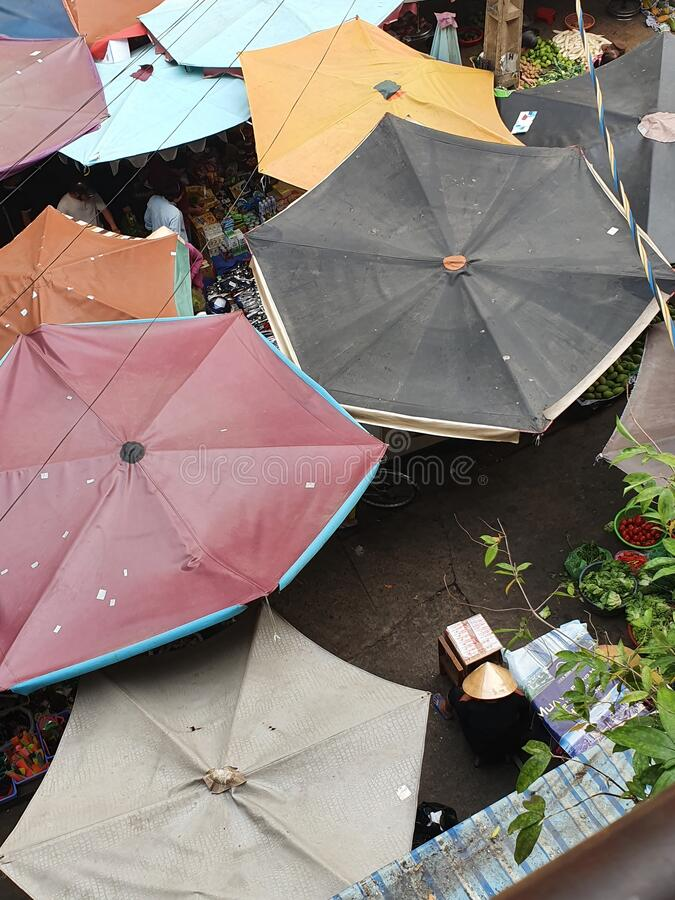 Umbrella covers open street market D4 HCMC, Vietnam stock images